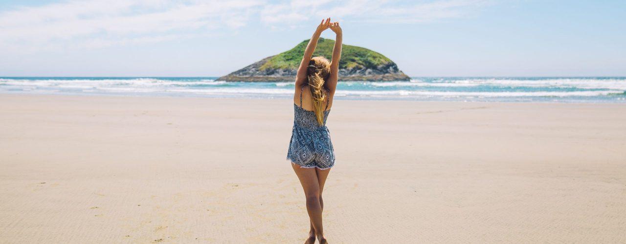 girl-on-beach-stretching