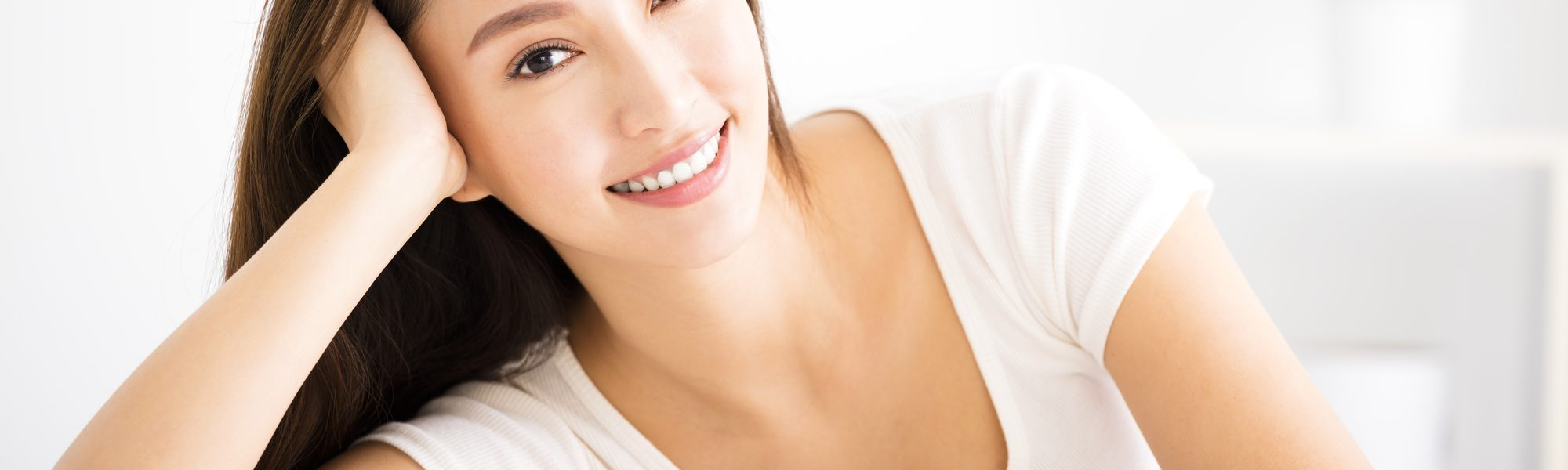 relaxed young smiling woman  in living room
